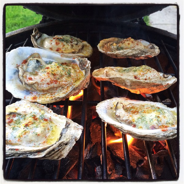 Melted compound butter on the oysters with some added paparika
