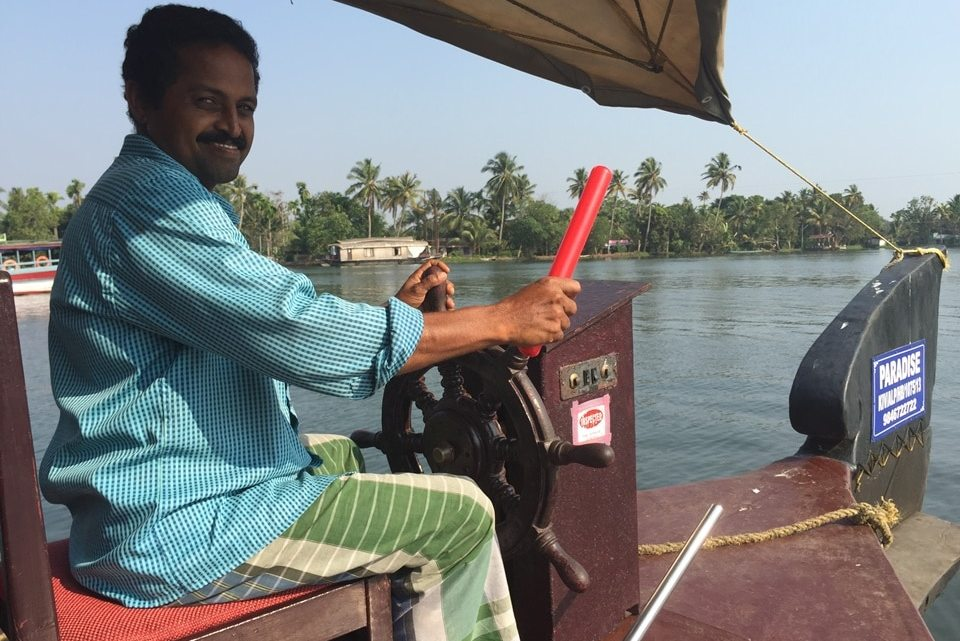 Navigating the Kerala Backwaters by Houseboat
