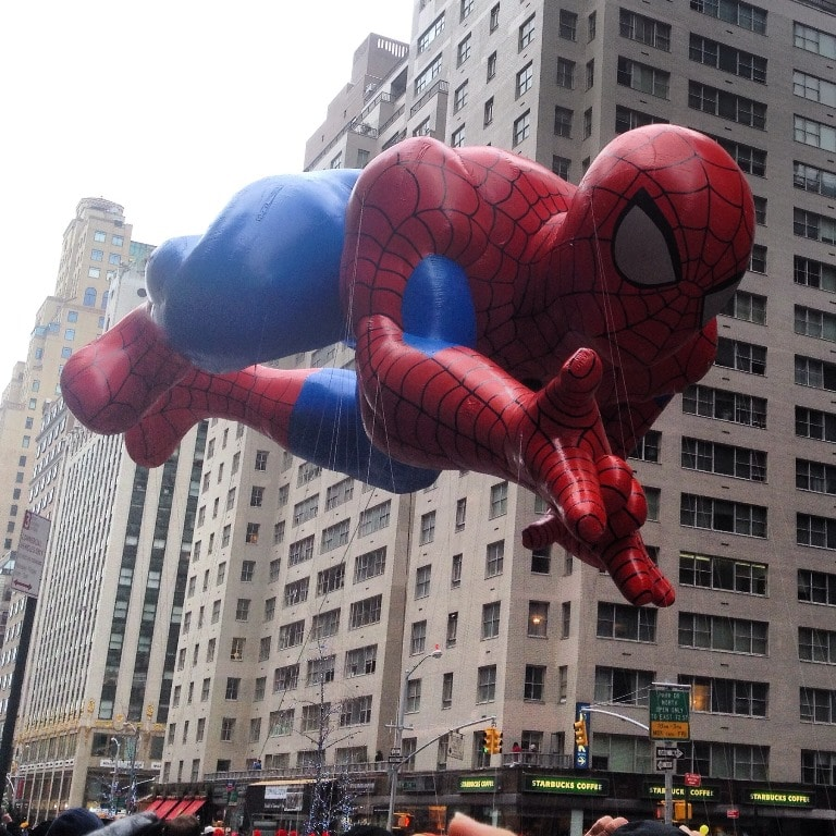 Spiderman flying down 6th Ave