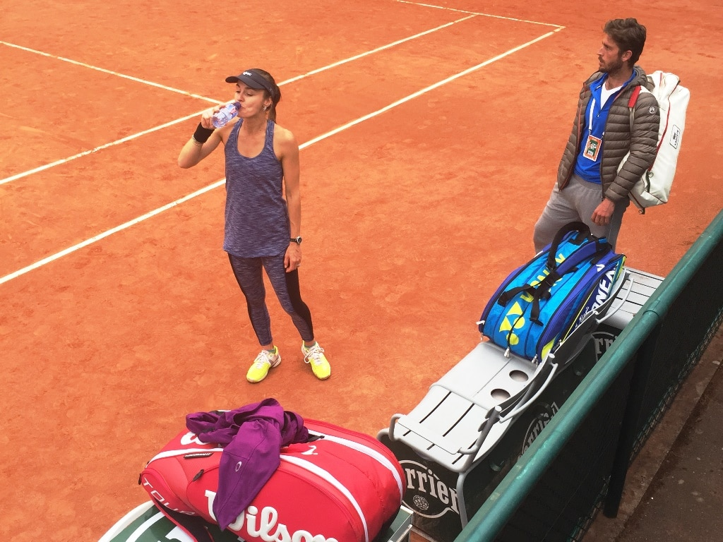Martina Hingis practising on an outside court