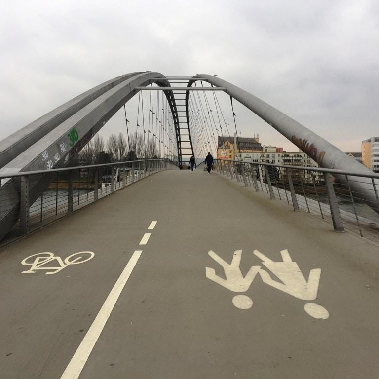 Walking across the Dreiländereck Bridge from France into Germany