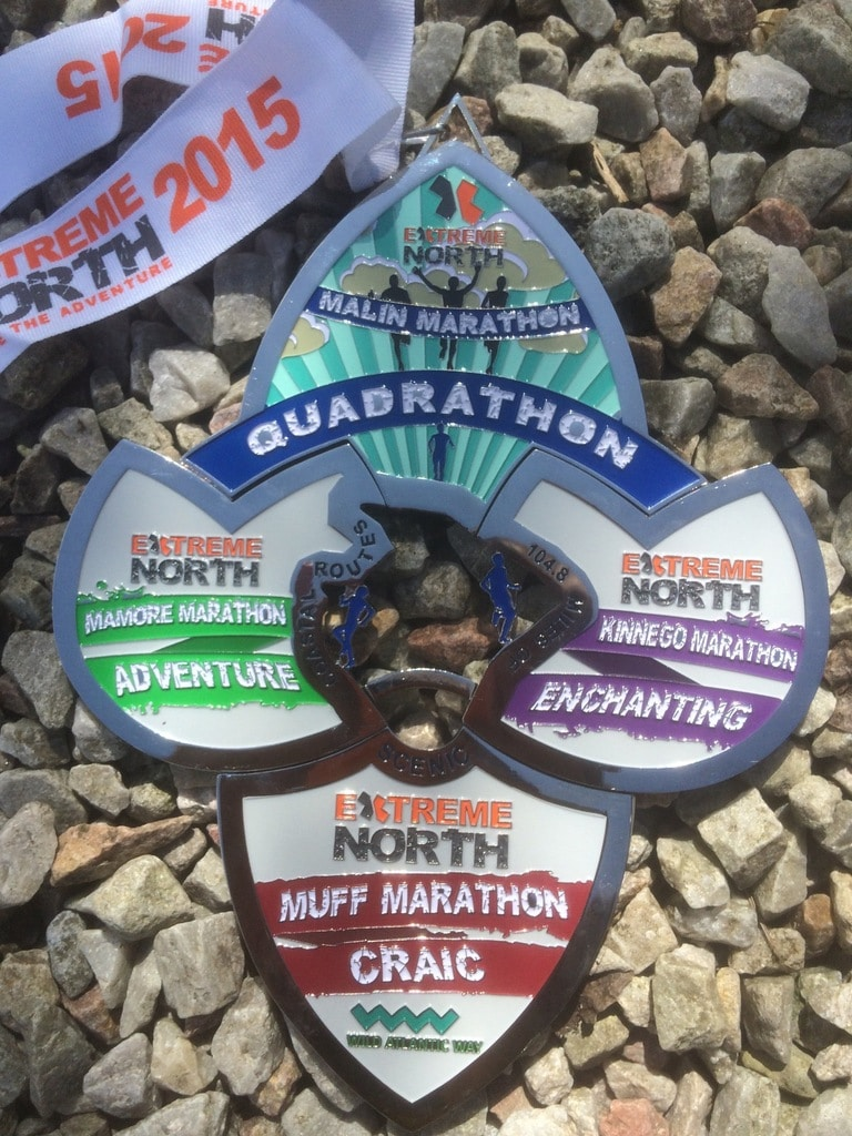The four medals of the Quadrathon marathons. Image from http://www.extremenorthevents.com/quadrathon-4-half-full-marathons/