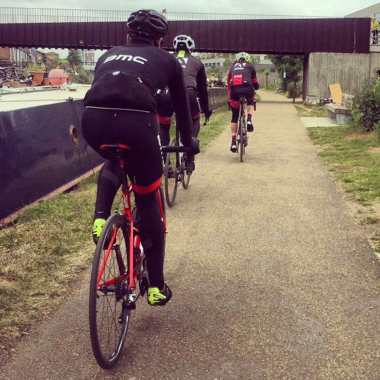Riding behind Cadel Evans along a towpath in East London