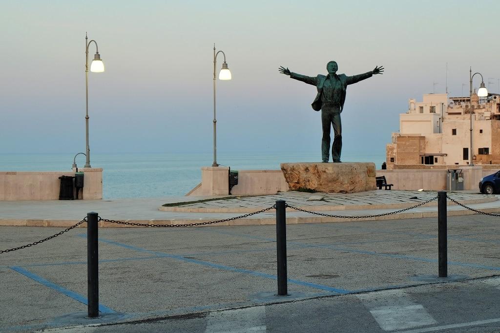 The Domenico Modugno statue in Polignano a Mare, Puglia, Italy