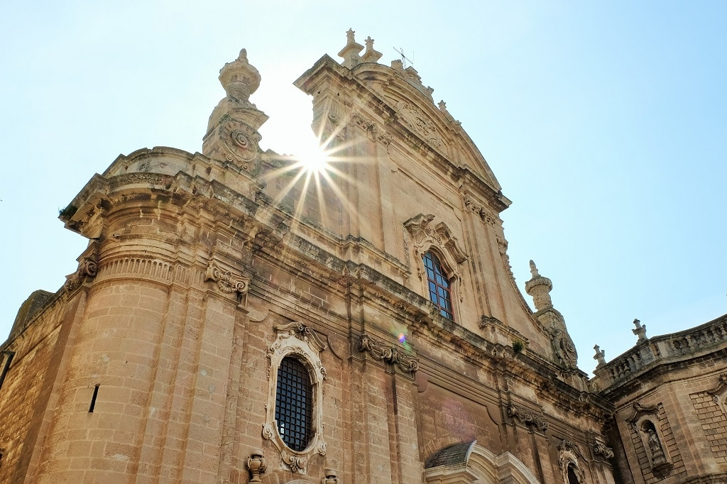 The sun poking out behind Monopoli Cathedral, Puglia, Italy