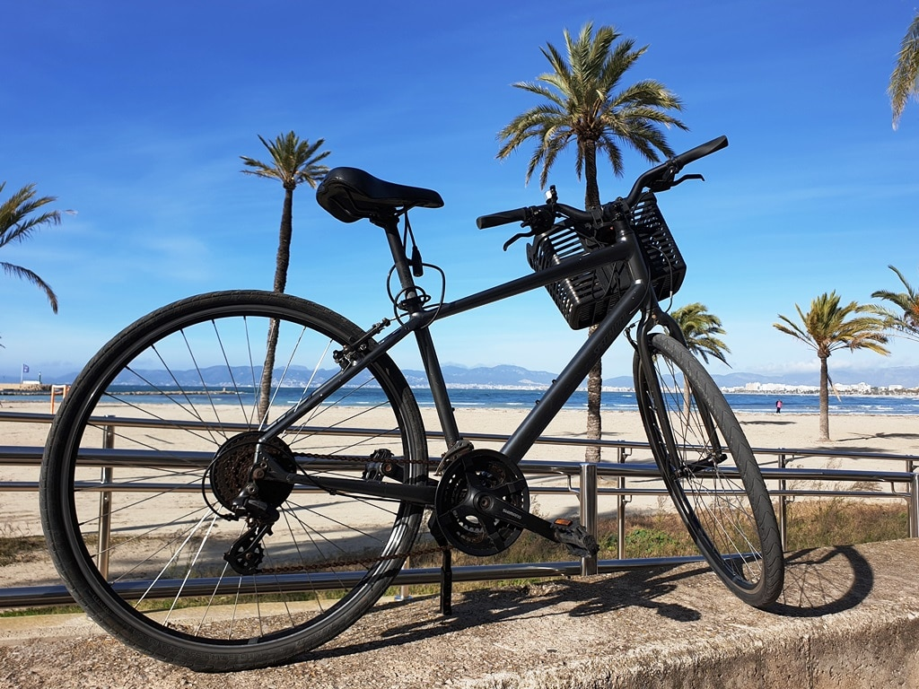 Bicycle at S'Arenal Beach with Palma in the background
