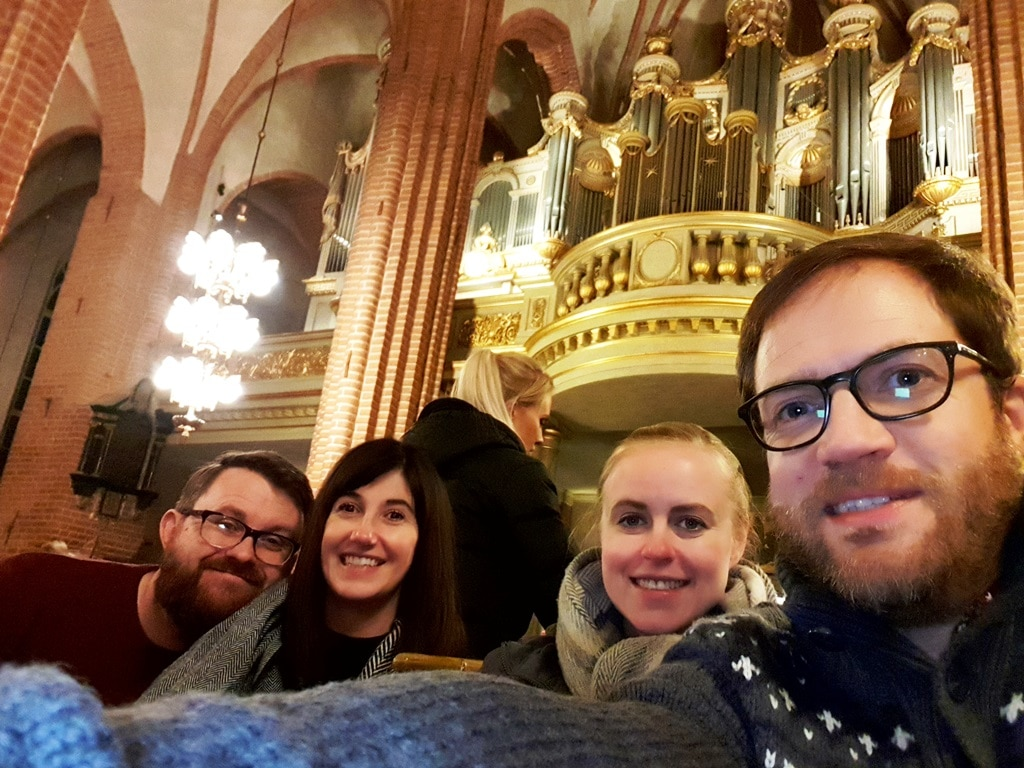 Group of four with the cathedral organ in the background