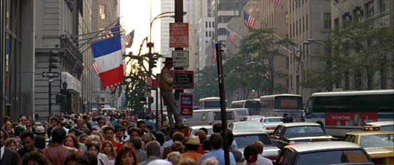 Crocodile Dundee up a lamppost on 5th Avenue.