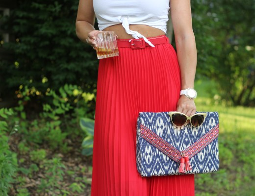 red white and blue, summer style, pleated maxi skirt, long red skirt, belted skirt, ikat, ikat clutch, cat eye sun glasses, front tie crop top, white crop top