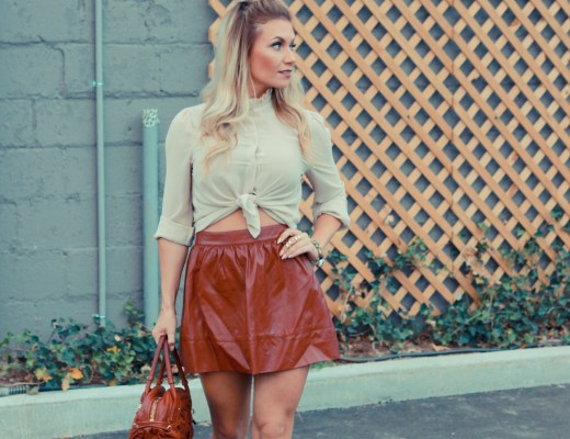 A deep red leather skater skirt paired with a victorian style button up blouse.