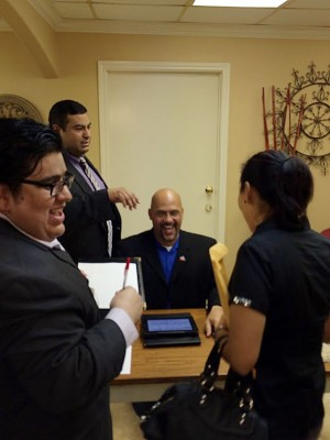 Artemio Muniz, Chris Carmona, and Trebor Gordon helping an applicant
