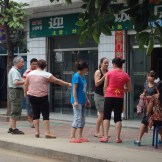 Kim and Fun interacting with the friendly locals (China)