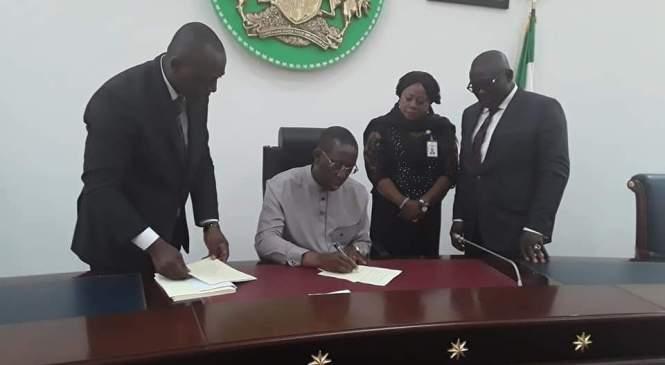 Okowa Signs Bill of N308.9 Billion 2018 Budget Into Law