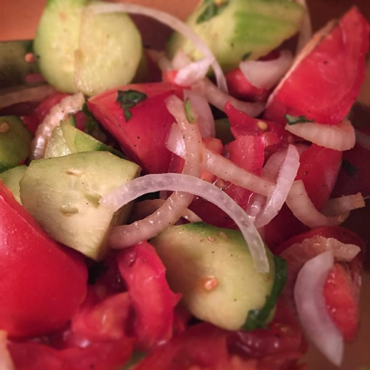 Tomato, cucumber, onion, basil salad. Perfect side dish to add a little freshness to any meal!