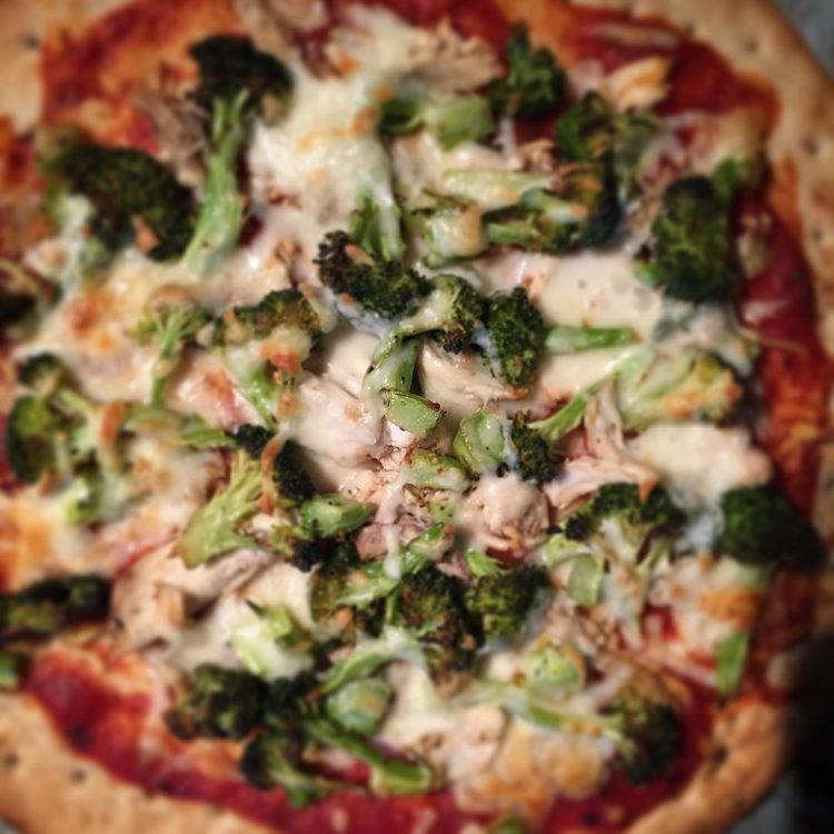 Make-your-own pizza night...again! On the menu tonight: roasted broccoli, chicken, and a combo of mozzarella and smoked cheddar. Let the eating begin:)