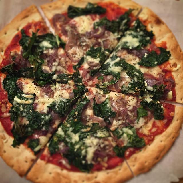 On the menu tonight Homemade kale and caramelized onion pizza!