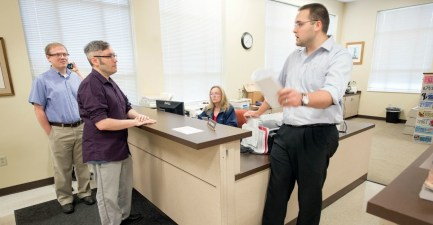 Rowan County Deputy Clerk Nathan Davis, right, informs David Moore, center, and David Ermold, left, that he won't issue them a marriage license Thursday, August 13, 2015 at the Rowan County Clerk's office in Morehead, Ky. Moore and Ermold were at the courthouse early Thursday following an order by a federal judge that Rowan County Clerk Kim Davis issue the licenses, despite her religious convictions. (John Flavell/Lexington Herald-Leader/TNS)