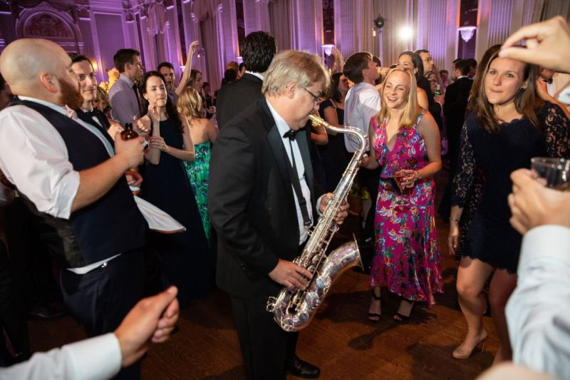 big-ray-and-the-kool-kats-saxaphone-player-playing-in-the-middle-of-crowd