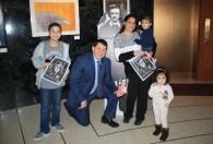 Superintendent Glenn Maleyko with a family celebrating Poe