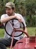 Robby found a tractor at the Worn Gruntin' Festival in Sopchoppy, FL. Photo taken by Ashley.