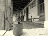 Memories fill an empty porch in Sopchoppy, FL. Photo by Ashley Jones.