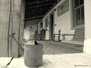 Memories fill an empty porch in Sopchoppy, FL. Photo by Ashley Jones.