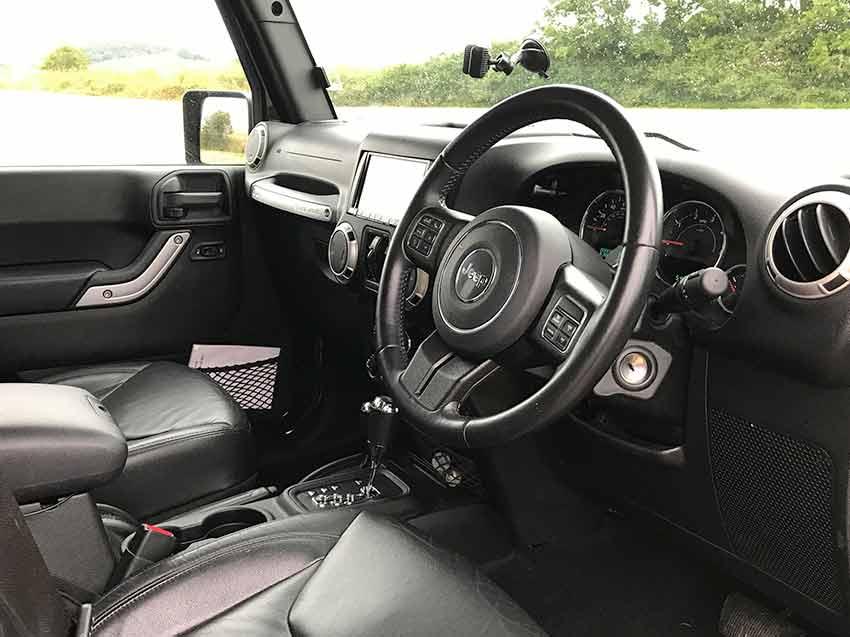 Jeep Wrangler campervan for hire in scotland interior driver seat