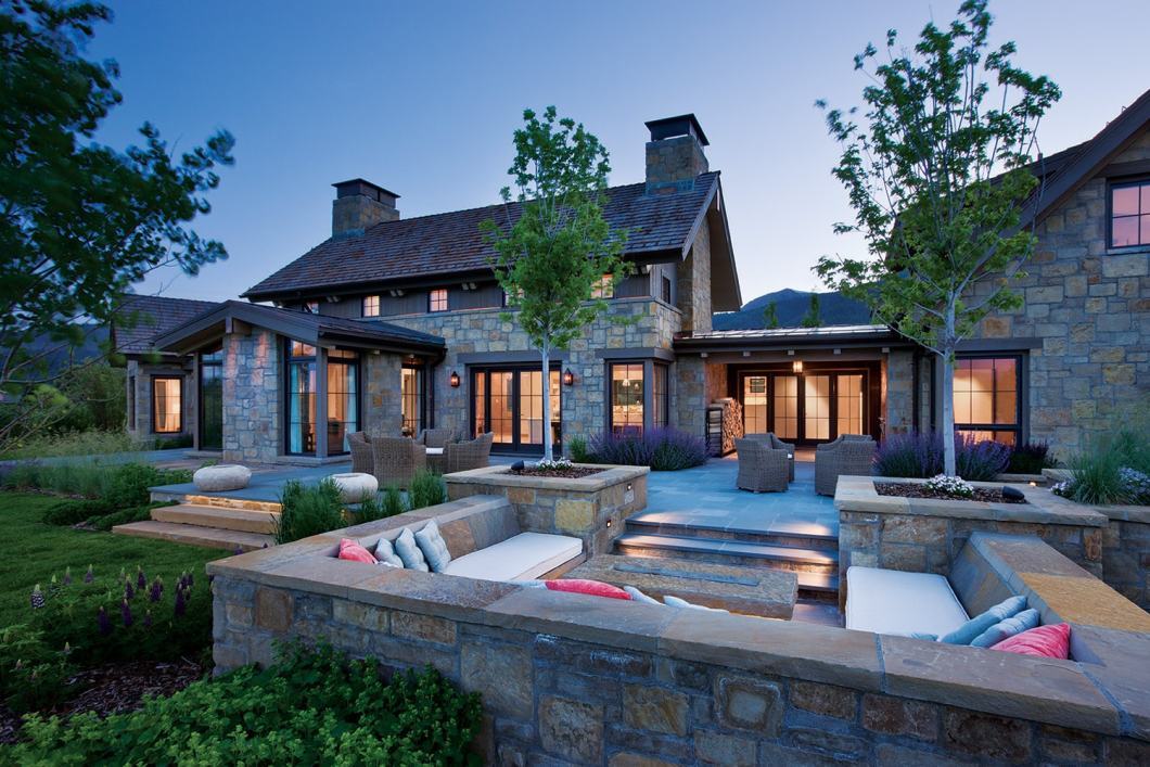 The Dykema home includes multiple outdoor living spaces, this one centered on a fire pit to take the chill off during the evening.
