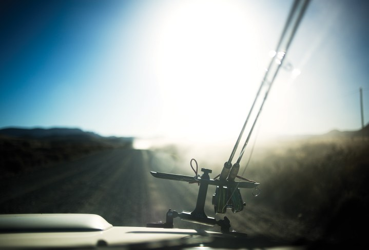 Fly rods hover over a dirt road in Argentina.