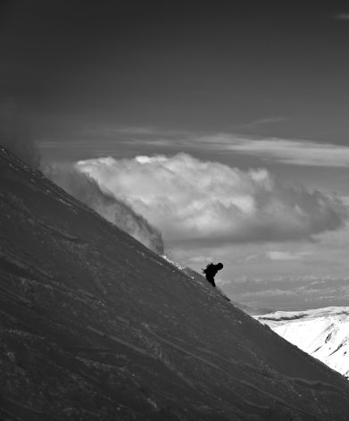 Turner captures his buddy Chad Zeigler's silhouette as he makes his way along the ridge of the North Summit Snowfield on the Moonlight Basin side of Big Sky Resort.