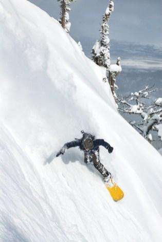 Snowboarder Josh Marcus rips through the fresh powder on the ridge at Bridger Bowl in Bozeman, Montana.