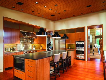 The kitchen exudes warmth while embracing clean, contemporary lines.