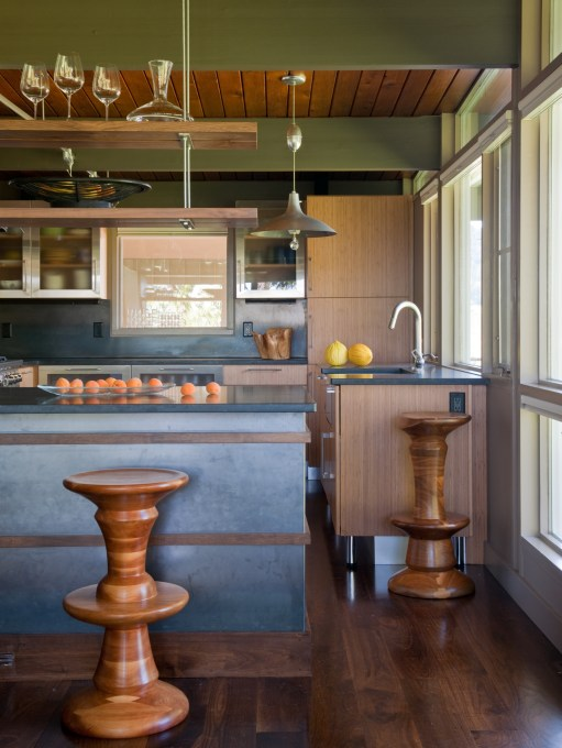 A casual dining area at the counter faces the kitchen (with eucalyptus cabinets); walnut stools from Bottega Montana.