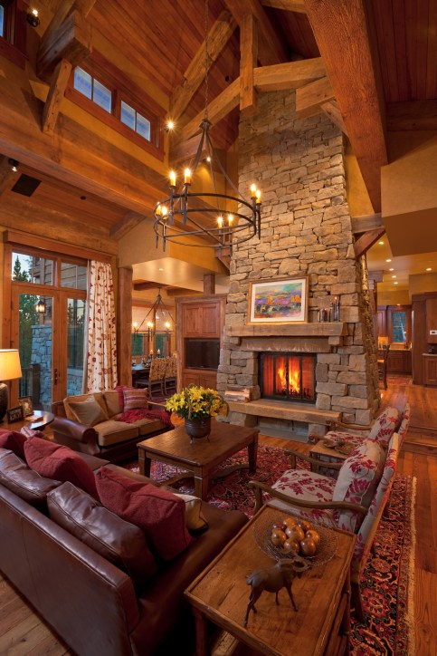 The common spaces on the main floor — the great room, dining room and kitchen — are anchored around this handsome stone chimney.