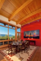 Panoramic views of the Teton range have been maximized at every opportunity including in the dining room where traditional family furniture is showcased in a warm contemporary space.