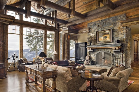The great room has two separate focal points, one around the stone hearth and the other to the views of wilderness and wildlife through the large windows.