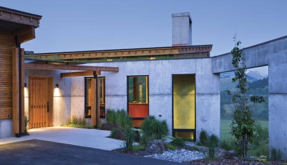 From the entry, the full span of this Modernist home is obscured, offering only hints at the beautiful views that unfold from inside the front door.