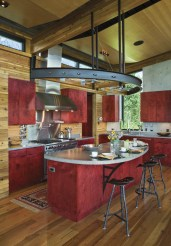Dyed Baltic birch cabinets add a burst of color to the neutral palette of wood, concrete and steel.