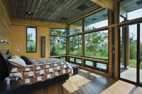 Still incorporating views and passive solar benefits, the master bedroom has a serene quality that contrasts the active main living-dining-kitchen portion of the home.