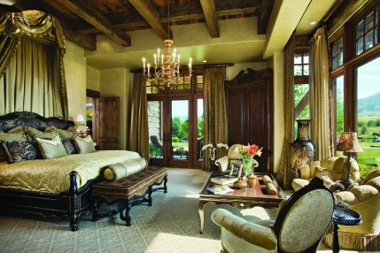 The master suite seems opulent with its European influenced interior design elements and golden tones from the plaster walls and the glow of the light that filters through the windows throughout the day.