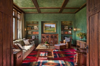 Hand-plastered walls in the den offer a quiet retreat with accents of bold color from a carpet Design Associates had custom-made for the room.