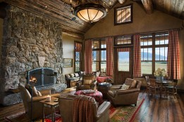 Lynette Zambon of Design Associates in Bozeman created an interior palette that incorporated antiques and new pieces to lend it a casual, comfortable feeling in the living room of the Fishing Lodge.