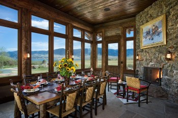 In the summer the wall of windows in the dining area are replaced with screens for guests to relish meals alfresco. Old Hickory chairs add a rustic flair.