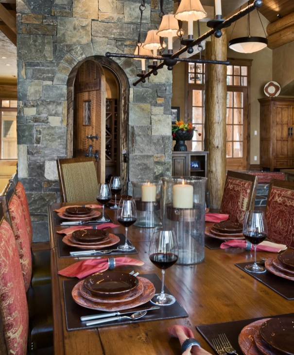 A wine cellar is built into the rock core of the home, right off of the dining room for easy access.