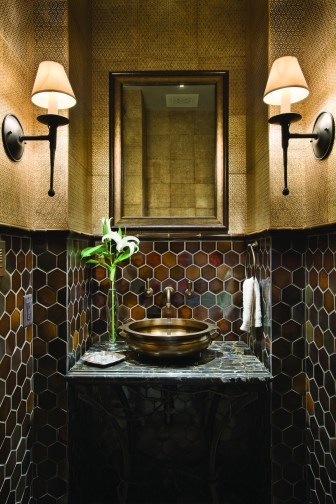 In this Yellowstone Club powder room, gold leaf tile creates a glowing warmth.