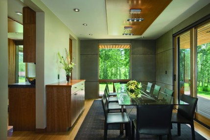 Enlarging the original windows fostered a contemporary open floorplan and allowed natural light to expand the living spaces in the dining room and throughout the house.