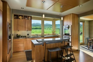 Custom furnishings, bamboo floors and clear pine cabinetry reinforce the sleek lines of the kitchen.