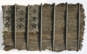 "Kate Hunt | ""Rebar Flag"" | Newspaper, Steel, Boat Building Epoxy | 41"" x 19"" x 6"""