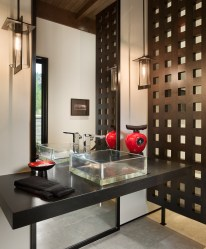 Custom walnut screens and modern fixtures meet a splash of bold color to create a comforting and restorative bath.