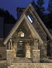 A broad staircase welcomes visitors to the front door of Raven's Roost. TLC Builders and Design Associates' attention to detail is already evident in the copper flashing along the roof and within the Scandinavian double gable entry.